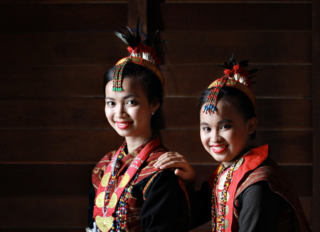 kota kinabalu: Kota Kinabalu, Sabah Malaysia.May 31, 2015 : Dusun Lotud girls in colorful traditional costume during Pesta Kaamatan or Harvest Festival in Sabah Borneo. Image contains shadow from natural lights.