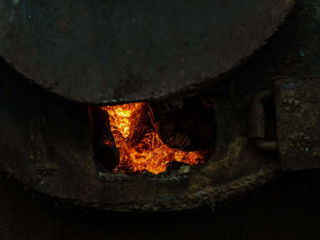 red hot coals in a blast furnace for metal melting. metal mining and processing industry. Red coal from a burnt fire made of wood