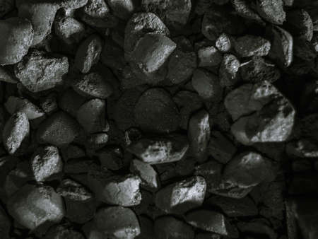 charcoal for barbecue in the grill, coals factory black and white photo