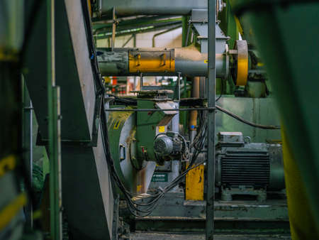 Manufacture of woods pellets. Close-up photo of equipment. Woodworking timber industry: machines and equipment for pressing and cutting sawn timber.