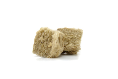 rockwool: Mineral wool for insulation. The fiberglass is isolated on white.