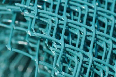 Green plastic fence, macro detail Stock Photo