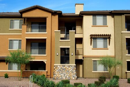 condominium: New 3-story condominium complex in gold and tan stucco with desert landscaping