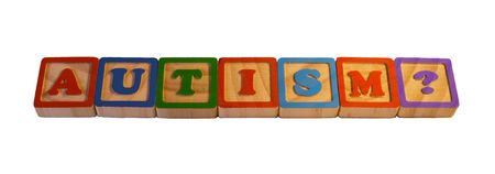 autism: A set of colored wooden blocks with painted letters, spelling the word autism with a question mark Stock Photo