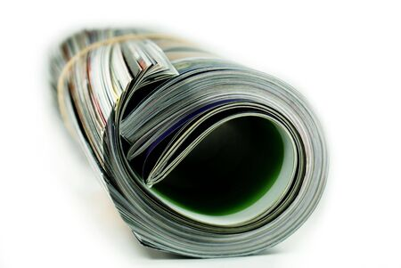 catalogs: Some print magazines or catalogs, rolled up