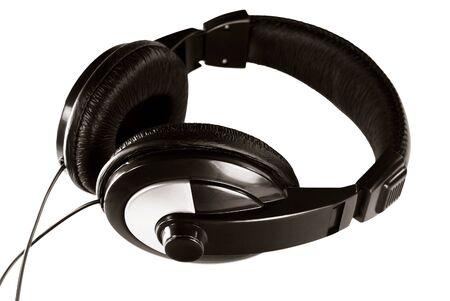 Black audio headphones isolated on white photo