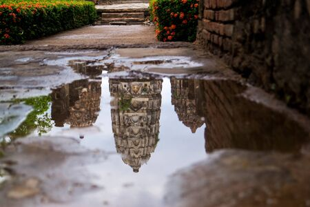 Khmer Pagoda reflected in a puddle 스톡 콘텐츠