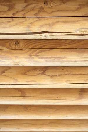 Textured horizontal wooden wall from logs. Wooden texture background Wall of blockhouse Reklamní fotografie