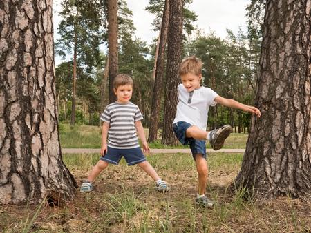 Happy children having fun outdoor. Good emotions effect. Foto de archivo