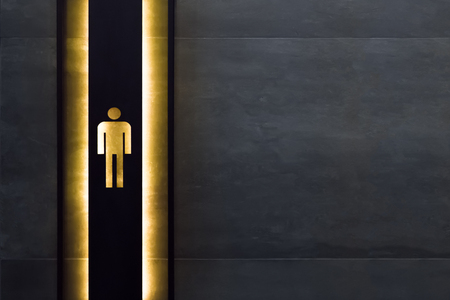 Male restroom sign. Restroom signs in public place. Important signs and symbols concept. Simple sign of WC. Restroom concept. Restroom sign on a toilet door. 版權商用圖片