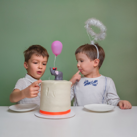 Tastying Delicious cake. Children Licking Birthday Cake Cream. Sweet table for children. Birthday cake. Funny happy kids. Elder brothers celebration of newborn sibling.