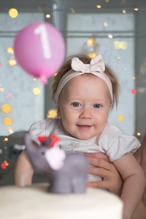 Toddler In Mothers Hands 1 Year Old Birthday Party Adorable Happy Children Background Smiling Girl And Cake One