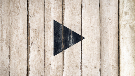 Video play button old wooden background. Black wood separated to pause symbol on wooden background.