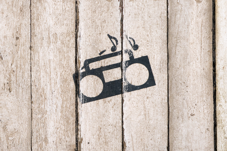 Music playing sign and symbol. Tape recorder with notes on wooden background. Delivery service. Bar, care, night club interior. Vintage, country style. Shipping terms and conditions. Web icon.