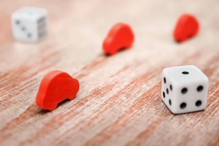 Car insurance background. Insurance policy service concept. Playing dice and wooden red cars on wooden background. Toy cars and playing dice. Conditions and risks of car insurance