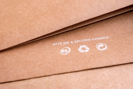 Reuse background. Words on craft paper. Recycle icons on brown paper. Give me a second chance. World resources concept. Reusing paper-based products. Ecological problems. Reusing concept.