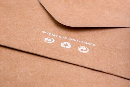 Brown envelope with recycling icons on it. Craft paper for packaging. SAVE PLANET concept. Life standarts concept. Stockfoto