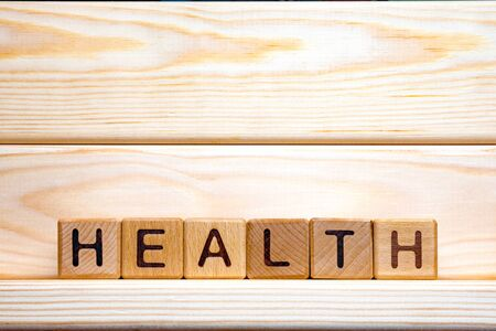 Word health written with wooden cubes. Health and medicine. Preventive medicine background. Assisting with medication. Care at home. Healthcare background