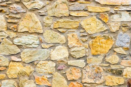 Stone wall. Wall of stones as a texture. Wall of stones. wall of a medieval fortress with mainly white or light colored stones of varying sizes and shapes, usable as background pattern or for designs