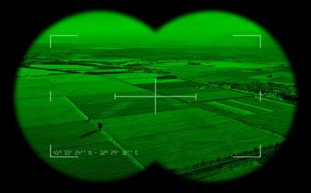 Empty view inside a military binocular. Night vision theme.