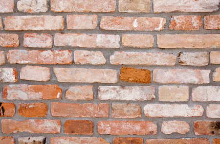 The red brick wall of a house in Italy. Year 1890.