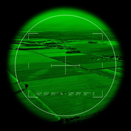 Empty view inside a military monocular. Night vision theme.