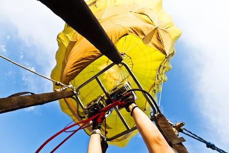 A hot air balloon taking off.  Partenza di una mongolfiera vista dal cesto. Stock Photo