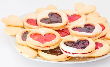 Plate of shortbread with jam heart-shaped