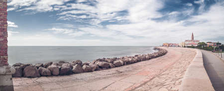 Coast with cloudy sky and sea in the background  Panoramic view