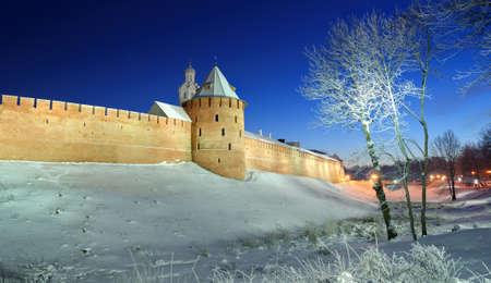 veliky: The Metropolitan Tower and Chasozvonya Clock tower of Novgorod Kremlin in winter night, Veliky Novgorod Editorial