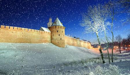 veliky: The Metropolitan Tower and Chasozvonya Clock tower of Novgorod Kremlin in winter night, Veliky Novgorod Stock Photo
