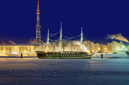 volkhov: VELIKY NOVGOROD, RUSSIA - DECEMBER 1. Night cityscape with restaurant frigate Flagship at the river Volkhov, Veliky Novgorod on December 1, 2014.