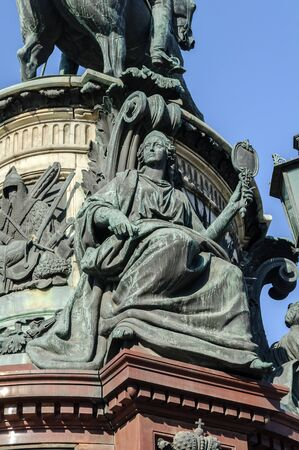allegoric: SAINT-PETERSBURG, RUSSIA - MARCH 17, 2015.  Allegorical sculpture Wisdom on the monument to Emperor Nicholas I at the Isaac Square.