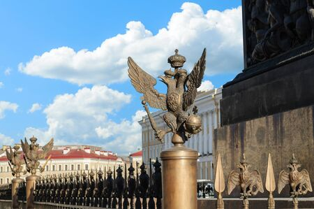 doubleheaded: Double-headed eagle in the imperial crown on the fence of the Alexander Column in St. Petersburg focus at the eagle Editorial