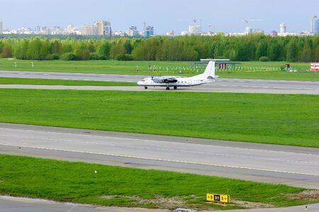 avia: SAINT-PETERSBURG, RUSSIA - MAY 23, 2015. Pskov Avia Antonov An-24-RV aircraft registration number RA-47800 rides on the runway after landing in Pulkovo International airport Editorial