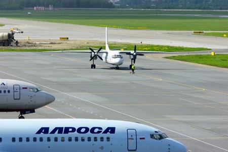avia: SAINT-PETERSBURG, RUSSIA - MAY 23, 2015. Pskov Avia Antonov An-24-RV aircraft registration number RA-47800  on the parking after landing in Pulkovo International airport