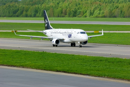 livery: SAINT-PETERSBURG, RUSSIA - MAY 23, 2015. LOT -Star Alliance Livery- Polish Airlines Embraer ERJ-170 aircraft -registration number SP-LDK- prepares for take-off from the runway of Pulkovo International Airport