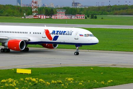 azur: SAINT-PETERSBURG, RUSSIA - MAY 23, 2015.  Azur Air Airline Boeing 757-2Q8  aircraft  registration number VQ-BQA prepares for take-off from the runway of Pulkovo International Airport Editorial