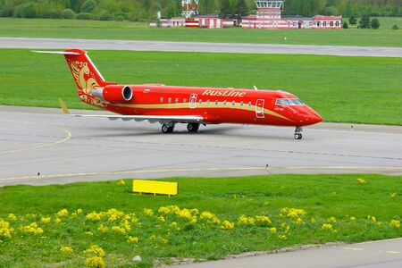 bombardier: SAINT-PETERSBURG, RUSSIA-MAY 23,2015.Rusline Airlines Bombardier Canadair Regional Jet CRJ-200 aircrafts registration number VQ-BNB rides on the runway after landing in Pulkovo International airport Editorial