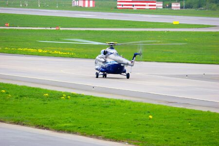 avia: SAINT-PETERSBURG, RUSSIA - MAY 23, 2015. The Mil Mi-8 AMT registration number RA-24181  helicopter of Sparc Avia Aviation Company rides on the runway after landing in Pulkovo International airport