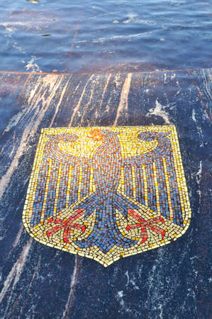 16 17: VELIKY NOVGOROD, RUSSIA - AUGUST 17, 2015. Coat of arms of Germany, represented in the Hanseatic fountain. The fountain consists of 16 coats of arms belonging to the Hanseatic League of the New Times. Stock Photo