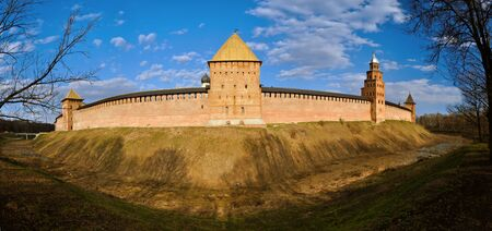 moat wall: Panoramic view of  Novgorod Kremlin towers in Veliky Novgorod, Russia. Spring beautiful architectural landscape in sunny weather.