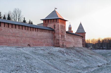veliky: The towers of Kremlin in Veliky Novgorod, Russia - winter architectural landscape at sunset Stock Photo