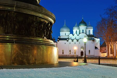 novgorod: St. Sophia Cathedral and the monument Millennium of Russia on the foreground in Veliky Novgorod, Russia. Winter night view Stock Photo