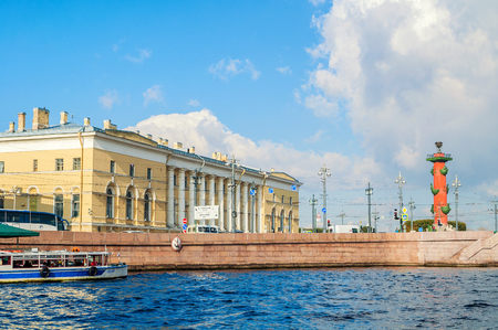 ST PETERSBURG, RUSSIA - OCTOBER 3, 2016. St Petersburg landmarks of Vasilievsky island spit - rostral column and building of Zoological Museum, former South Exchange Warehouse in St Petersburg, Russia