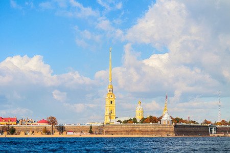 Panorama of Saint Petersburg, Russia- architecture ensemble of Peter and Paul fortress and Neva river in sunny autumn weather. Autumn architecture view of Saint Petersburg landmark in sunny day