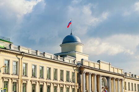 fasade: Fasade of Leningrad Regional Court building on the Fontanka River in Saint Petersburg, Russia - closeup facade view with Russian flag on the roof flagpole in sunny day