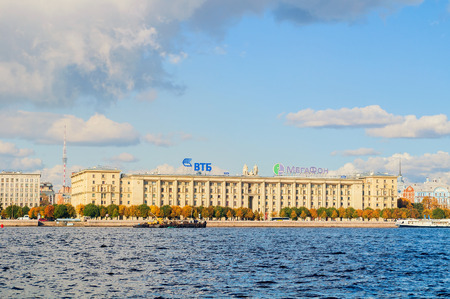 ST PETERSBURG, RUSSIA - OCTOBER 3, 2016. Petrovsky embankment - residential house for employees of Peoples Commissariat of the USSR Navy. On the roof - logos of VTB bank and Megafon company
