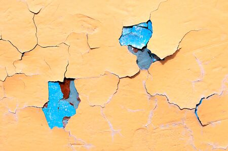 Texture background of light orange and turquoise peeling paint on the old rough texture surface - texture background with chipped grunge paint on the texture wall Stock Photo