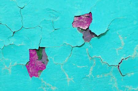 Texture background of light blue and red peeling paint on the old rough surface - texture background with chipped grunge paint on the texture wall Stock Photo